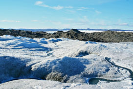 clear blue sky over the an icy landscape, crossed by a river