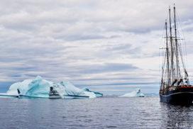 sailing vessel rembrandt van rijn among blue icebergs under a cloudy sky