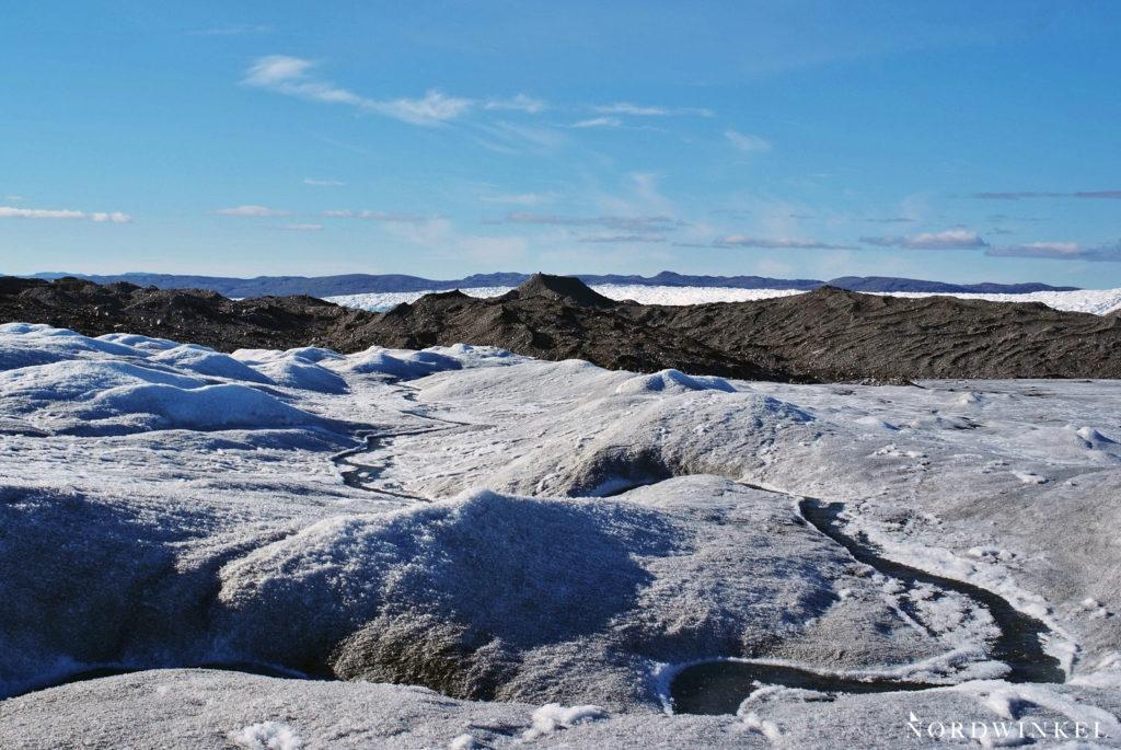 ausläufer inlandseis vor geröllmoräne eines gletschers